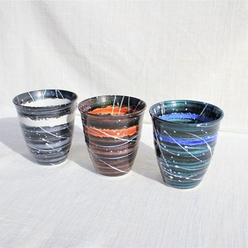 光彩釉 銀河 焼酎カップ <br />光彩釉で仕上げた銀河シリーズの焼酎カップです。 カップに手を添える場所や、光の加減でいろんな表情を見ることができます。 飲み口もシャープな作りになっており、程よい大きさですので、フリーカップとしてもお使いいただけます。